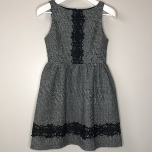 Women's black and white party dress altar'd state